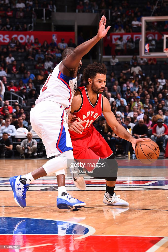 Drew Crawford #11 of the Toronto Raptors handles the ball against the Los Angeles Clippers on October 5, 2016 at STAPLES Center in Los Angeles, California.
