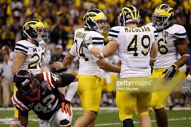 Drew Dileo Brendan Gibbons John McColgan and Kevin Koger of the Michigan Wolverines celebrate after Gibbons kicked a successful 39yard field goal in...