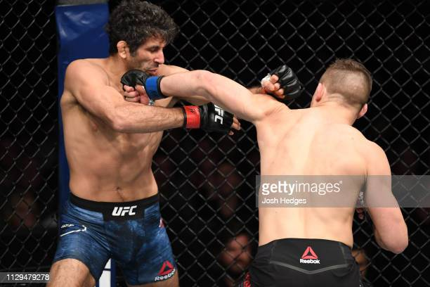 Drew Dober punches Beneil Dariush in their lightweight bout during the UFC Fight Night event at Intrust Bank Arena on March 9, 2019 in Wichita,...