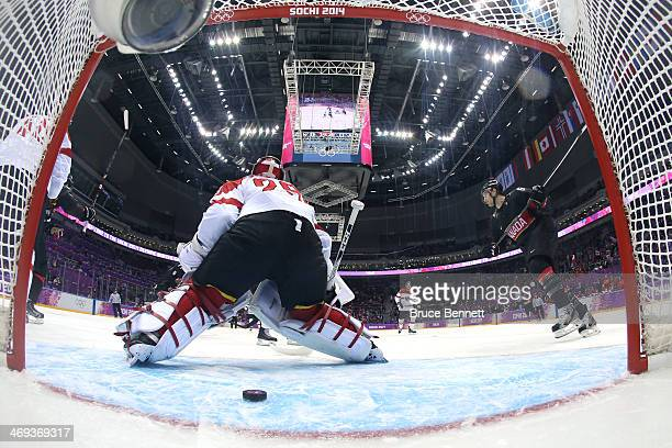 Drew Doughty of Canada scoring a goal in the first period against Bernhard Starkbaum of Austria during the Men's Ice Hockey Preliminary Round Group B...