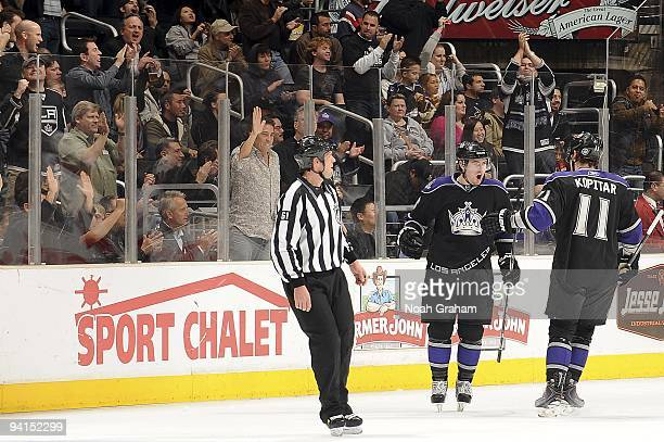 Drew Doughty and Anze Kopitar of the Los Angeles Kings celebrate a goal against the Ottawa Senators during the game on December 3, 2009 at Staples...