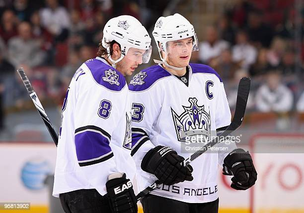 Drew Doughty and Dustin Brown of the Los Angeles Kings talk during the NHL game against the Phoenix Coyotes at Jobing.com Arena on December 26, 2009...