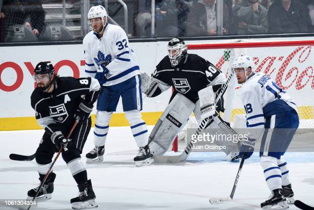 Drew Doughty and goaltender Cal Petersen of the Los Angeles Kings and Josh Leivo and Andreas Johnsson of the Toronto Maple Leafs look on during...