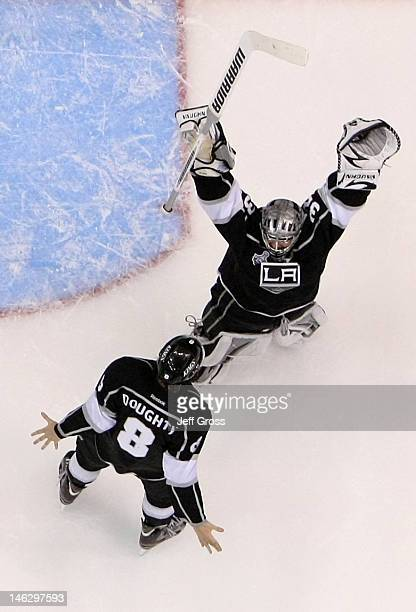 Drew Doughty and goaltender Jonathan Quick of the Los Angeles Kings celebrate the Kings 61 victory as they win the Stanley Cup final series 42 after...