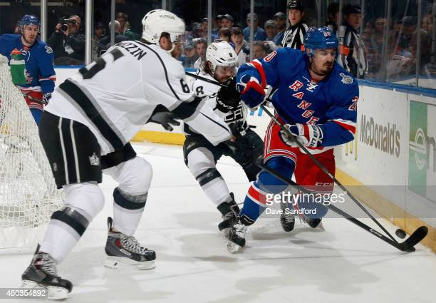 Drew Doughty and Jake Muzzin of the Los Angeles Kings defend by20 in the first period of Game Three of the 2014 Stanley Cup Final at Madison Square...