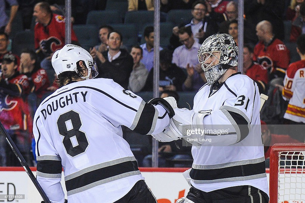 Drew Doughty #8 (L) and Martin Jones #31 of the Los Angeles Kings celebrate after defeating the Calgary Flames during an NHL game at Scotiabank Saddledome on March 10, 2014 in Calgary, Alberta, Canada. The Kings defeated the Flames 3-2.