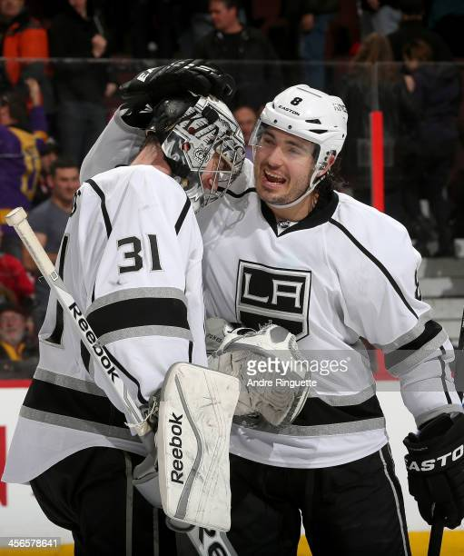 Drew Doughty and Martin Jones of the Los Angeles Kings celebrate their win against the Ottawa Senators at Canadian Tire Centre on December 14 2013 in...