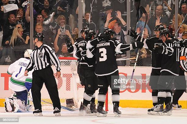Drew Doughty Jack Johsnon and Anze Kopitar of the Los Angeles Kings celebrate after a goal against Roberto Luongo of the Vancouver Canucks in Game...