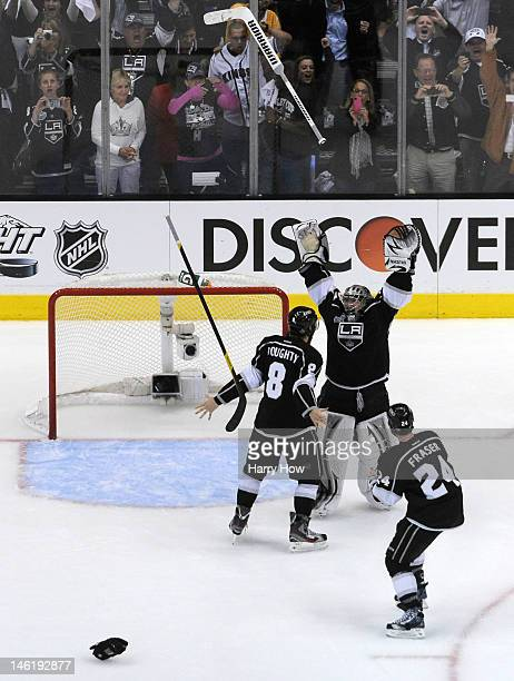 Drew Doughty Jonathan Quick and Colin Fraser of the Los Angeles Kings celebrate the Kings 61 victory as they win the Stanley Cup series 42 after Game...