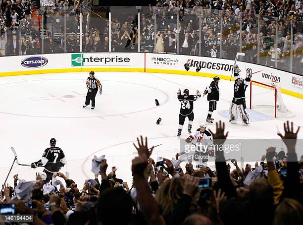 Drew Doughty Jonathan Quick and Colin Fraser of the Los Angeles Kings celebrate the Kings 61 victory as they win the Stanley Cup final series 42...