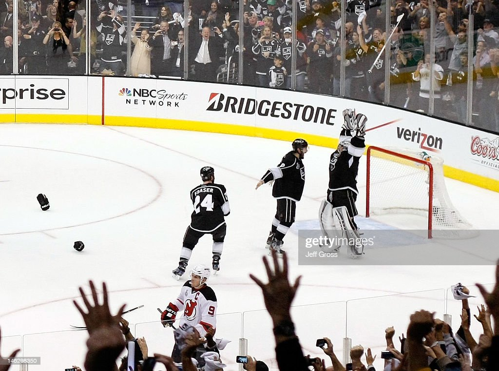 Drew Doughty #8, Jonathan Quick #32 and Colin Fraser #24 of the Los Angeles Kings celebrate the Kings 6-1 victory as they win the Stanley Cup final series 4-2 after Game Six of the 2012 Stanley Cup Final at Staples Center on June 11, 2012 in Los Angeles, California.