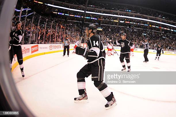 Drew Doughty, Justin Williams and Jack Johnson of the Los Angeles Kings react after the game winning goal with less than a second remaining in...
