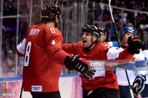 Drew Doughty of Canada celebrates with his teammate John Tavares after scoring the game winning goal in overtime against Tuukka Rask of Finland...