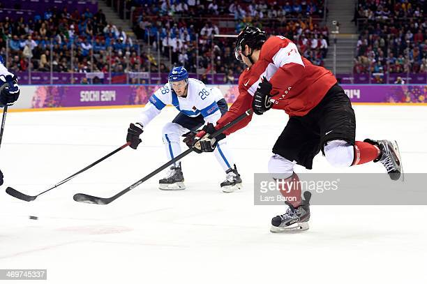 Drew Doughty of Canada scores the game winning goal in overtime against Tuukka Rask of Finland during the Men's Ice Hockey Preliminary Round Group B...