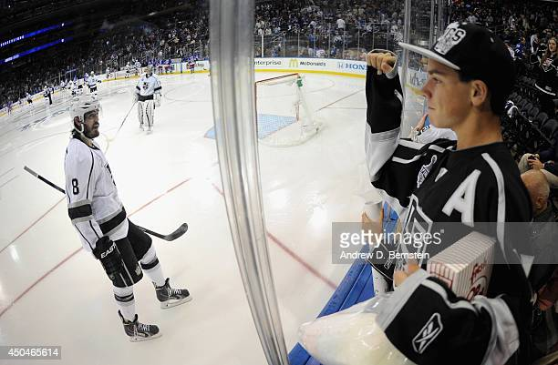 Drew Doughty of the Los Angeles Kings acknowledges an Los Angeles Kings fan in the third period of Game Four of the 2014 Stanley Cup Final at Madison...