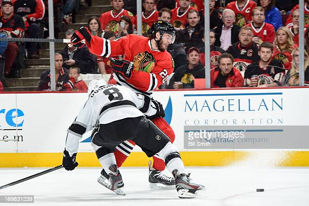 Drew Doughty of the Los Angeles Kings and Brandon Saad of the Chicago Blackhawks collide in Game Two of the Western Conference Final during the 2013...