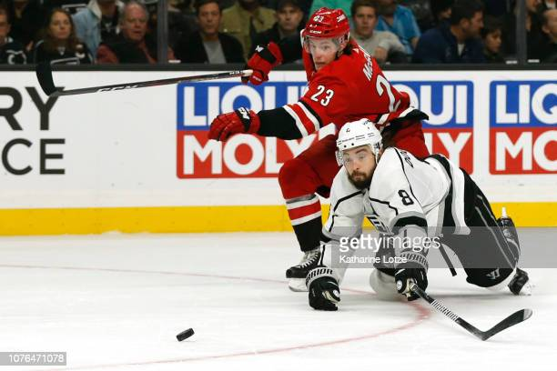 Drew Doughty of the Los Angeles Kings and Brock McGinn of the Carolina Hurricanes fight for control of the puck during the second period at Staples...