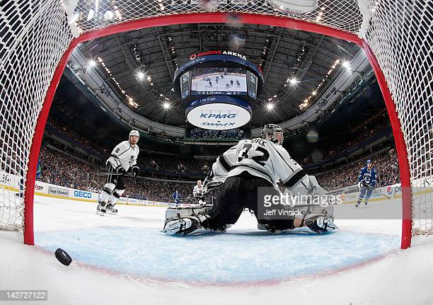 Drew Doughty of the Los Angeles Kings and Henrik Sedin of the Vancouver Canucks watch as the shot by Alex Burrows of the Canucks beats Jonathan Quick...