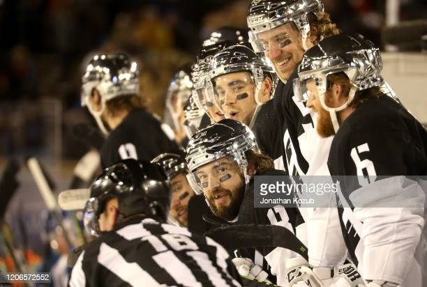 Drew Doughty of the Los Angeles Kings and his teammates look on from the bench during the third period of the 2020 NHL Stadium Series game between...