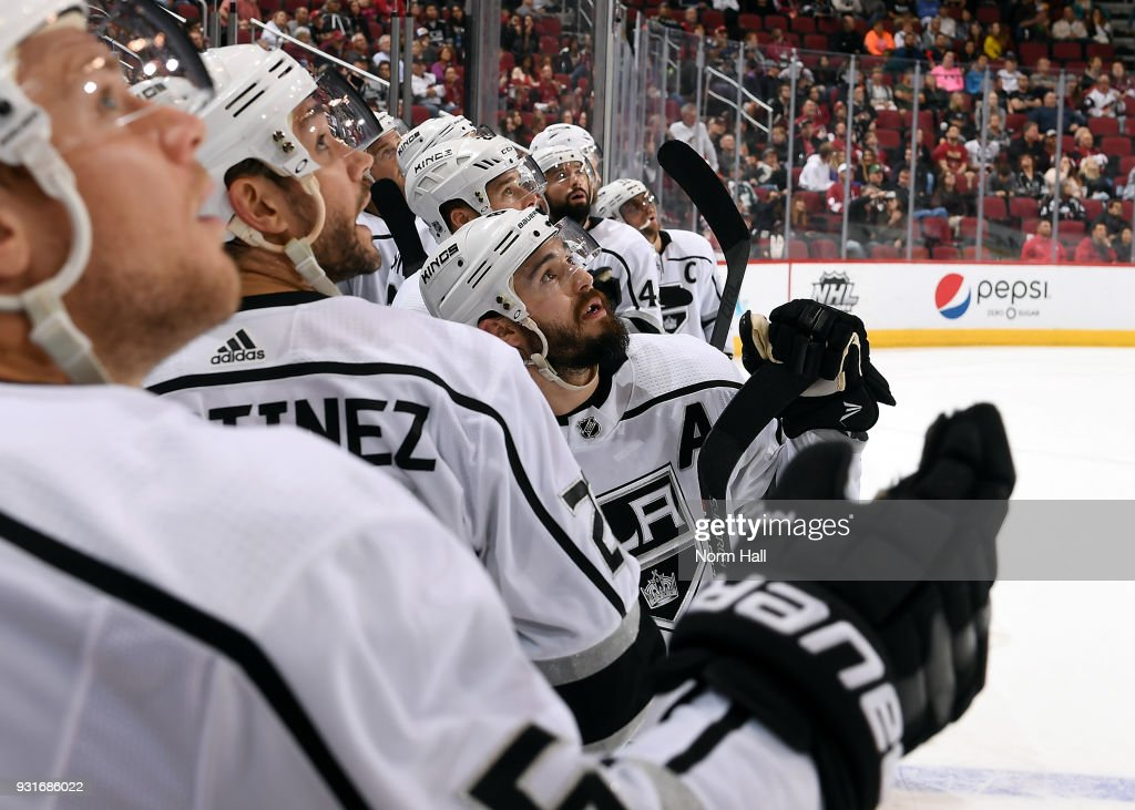 Drew Doughty #8 of the Los Angeles Kings and his teammates watch a video replay of a goal against the Arizona Coyotes during the overtime period at Gila River Arena on March 13, 2018 in Glendale, Arizona.