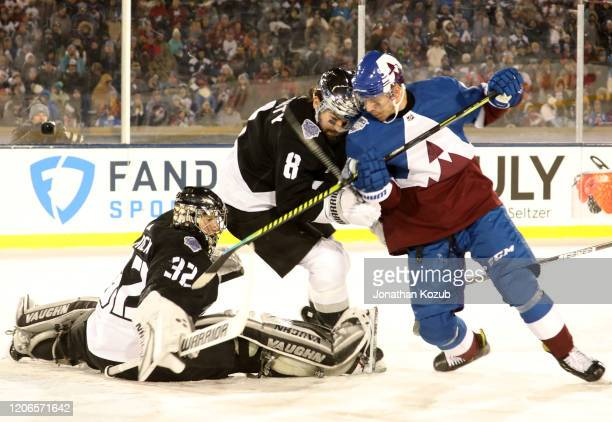 Drew Doughty of the Los Angeles Kings and Joonas Donskoi of the Colorado Avalanche vie for position in front of goaltender Jonathan Quick of the Los...