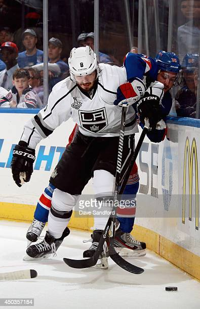 Drew Doughty of the Los Angeles Kings and Mats Zuccarello of the New York Rangers battle at the board during the second period of Game Three of the...