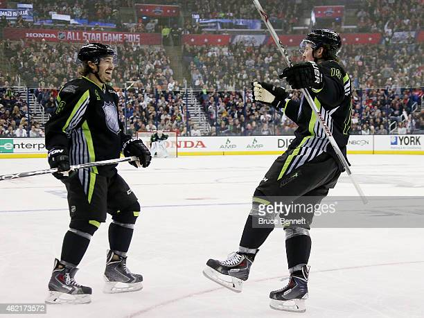Drew Doughty of the Los Angeles Kings and Team Foligno celebrates with Ryan Johansen of the Columbus Blue Jackets and Team Foligno during the 2015...