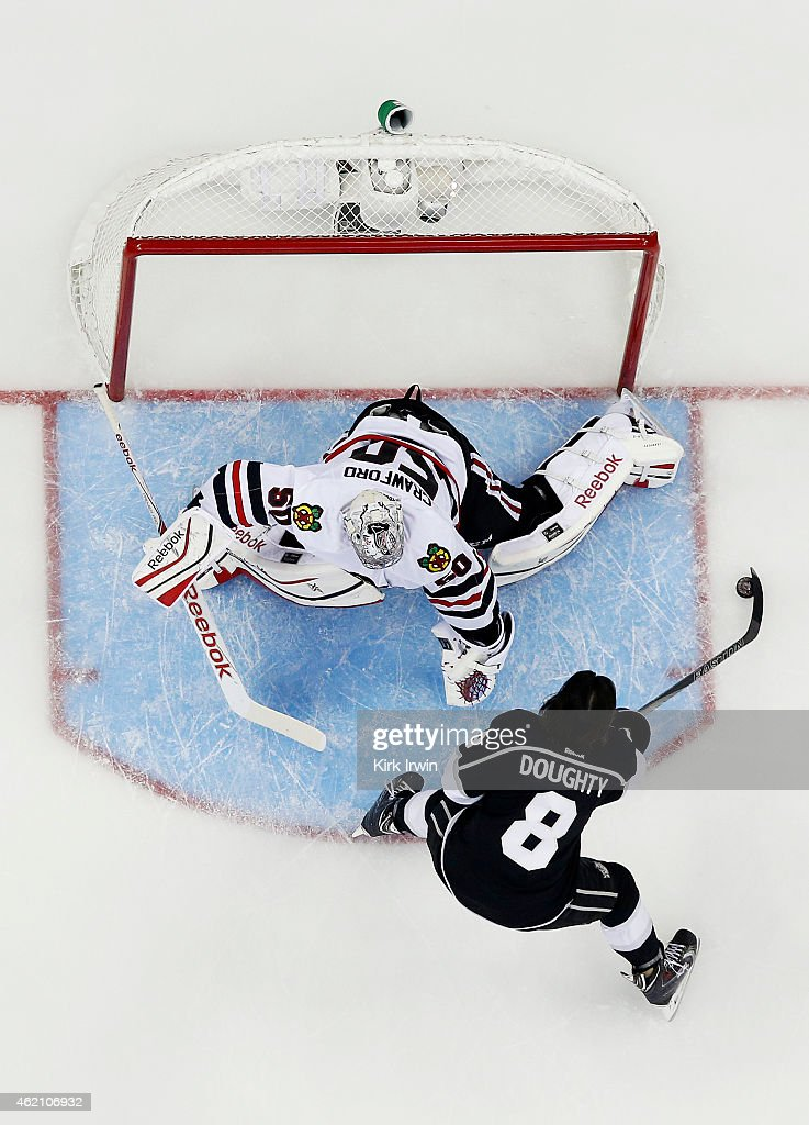 Drew Doughty #8 of the Los Angeles Kings and Team Foligno takes a shot on Corey Crawford #50 of the Chicago Blackhawks and Team Toews during the Discover NHL Shootout event of the 2015 Honda NHL All-Star Skills Competition at Nationwide Arena on January 24, 2015 in Columbus, Ohio.