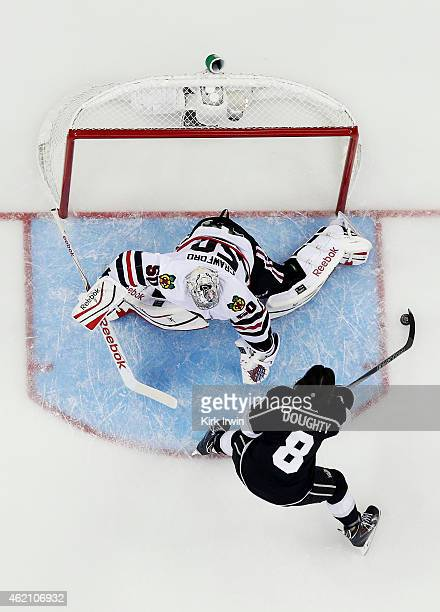 Drew Doughty of the Los Angeles Kings and Team Foligno takes a shot on Corey Crawford of the Chicago Blackhawks and Team Toews during the Discover...