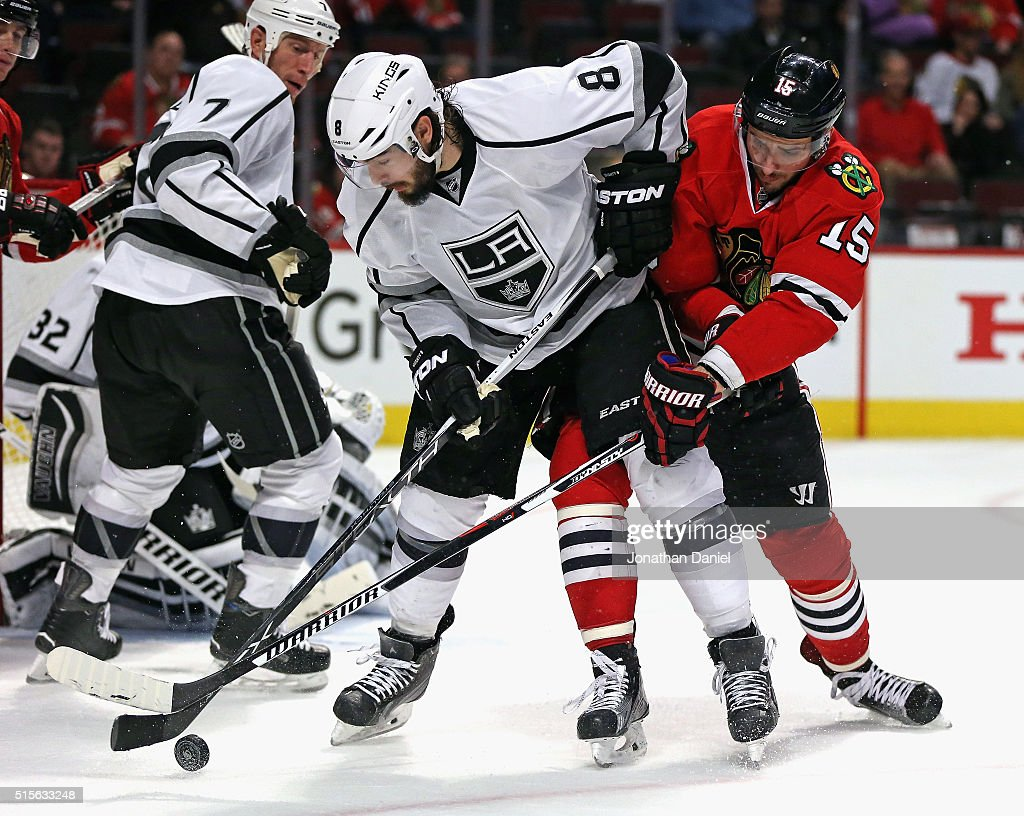 Drew Doughty #8 of the Los Angeles Kings battles for the puck with Artem Anisimov #15 of the Chicago Blackhawks at the United Center on March 14, 2016 in Chicago, Illinois. The Kings defeated the Blackhawks 5-0.