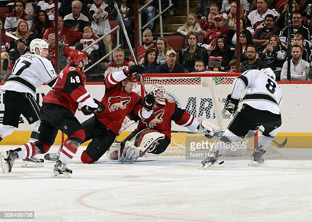 Drew Doughty of the Los Angeles Kings can't control the puck as he moves in for a shot against goalie Louis Domingue of the Arizona Coyotes as...