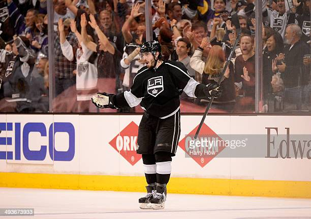 Drew Doughty of the Los Angeles Kings celebrates after he scores a third period goal against the Chicago Blackhawks in Game Three of the Western...