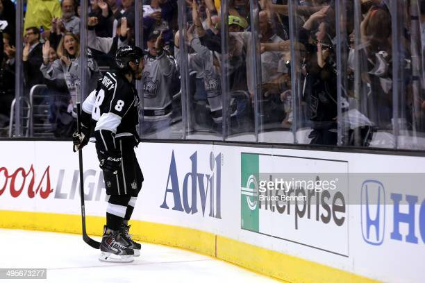 Drew Doughty of the Los Angeles Kings celebrates after scoring a goal against Henrik Lundqvist of the New York Rangers to tie the game in the second...