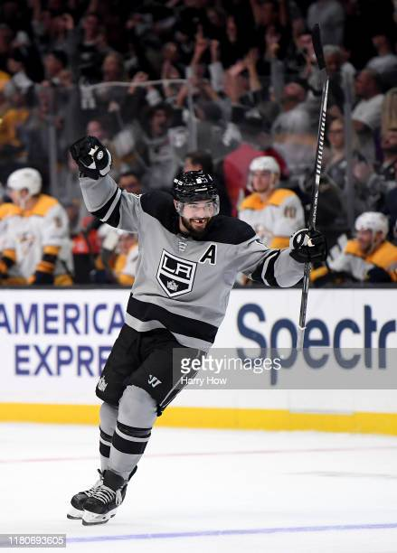 Drew Doughty of the Los Angeles Kings celebrates an empty net goal from Dustin Brown, to take a 6-4 lead over the Nashville Predators, during a 7-4...