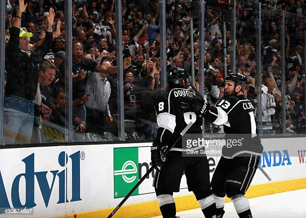 Drew Doughty of the Los Angeles Kings celebrates his goal with teammate Kyle Clifford against the New York Rangers in the second period of Game One...