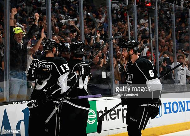 Drew Doughty of the Los Angeles Kings celebrates his goal with teammates Kyle Clifford Justin Williams and Jake Muzzin against the New York Rangers...