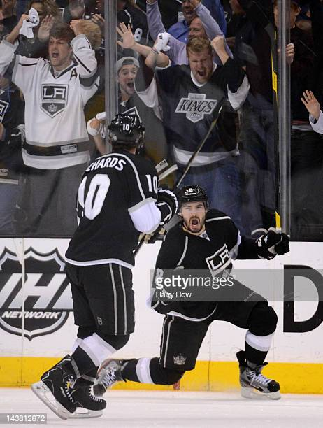 Drew Doughty of the Los Angeles Kings celebrates his third period goal with teammate Mike Richards against the St Louis Blues in Game Three of the...