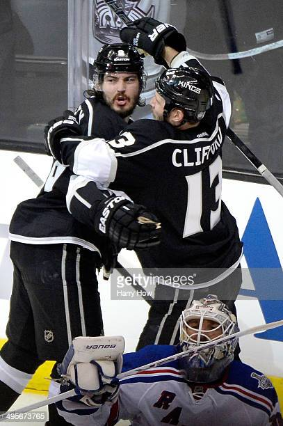 Drew Doughty of the Los Angeles Kings celebrates with Kyle Clifford after scoring a goal against Henrik Lundqvist of the New York Rangers to tie the...