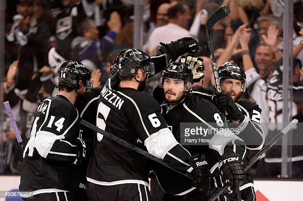 Drew Doughty of the Los Angeles Kings celebrates with teammates after he scores a third period goal against the Chicago Blackhawks in Game Three of...