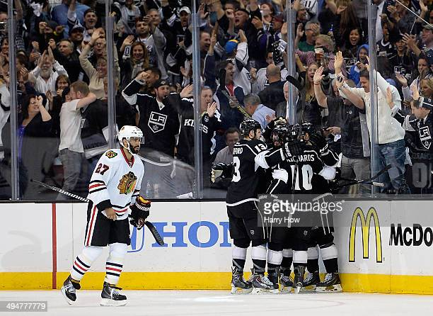 Drew Doughty of the Los Angeles Kings celebrates with teammates after scoring a third period goal against the Chicago Blackhawks in Game Six of the...