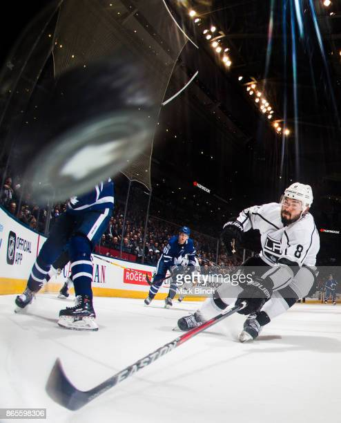 Drew Doughty of the Los Angeles Kings chases the puck during the third period against the Toronto Maple Leafsat the Air Canada Centre on October 23...