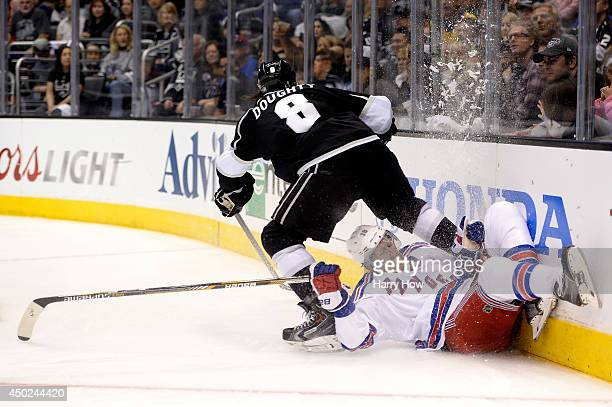 Drew Doughty of the Los Angeles Kings checks Marc Staal of the New York Rangers in the second period during Game Two of the 2014 NHL Stanley Cup...