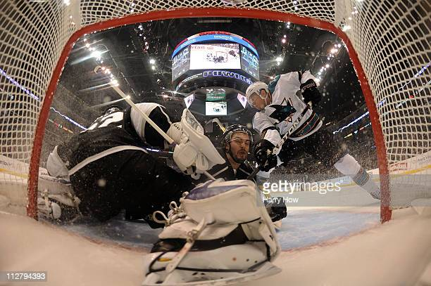 Drew Doughty of the Los Angeles Kings collides with Jonathan Quick in the net as Joe Pavelski of the San Jose Sharks tries to score in the first...