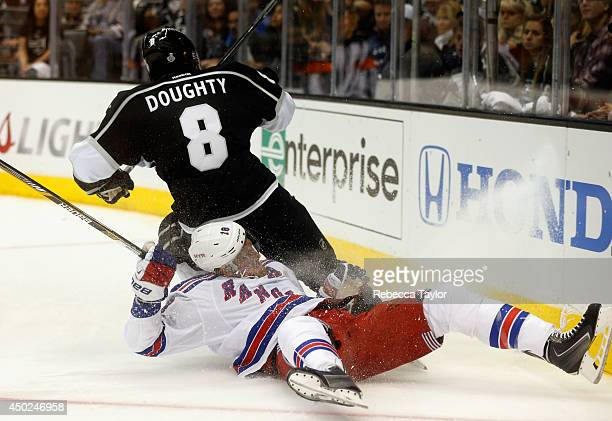 Drew Doughty of the Los Angeles Kings collides with Marc Staal of the New York Rangers in the second period of Game Two of the 2014 Stanley Cup Final...