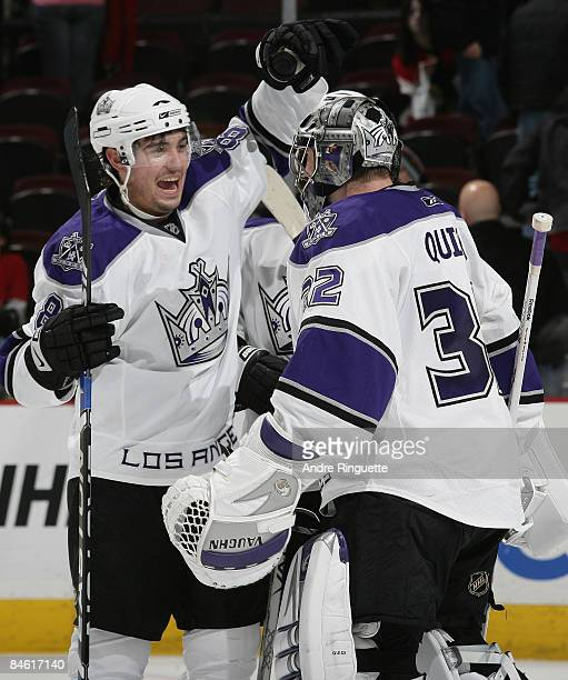 Drew Doughty of the Los Angeles Kings congratulates teammate Jonathan Quick for his shutout win over the Ottawa Senators at Scotiabank Place on...