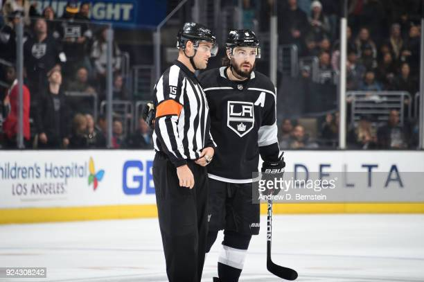 Drew Doughty of the Los Angeles Kings converses with referee Jean Hebert during a game against the Edmonton Oilers at STAPLES Center on February 24...