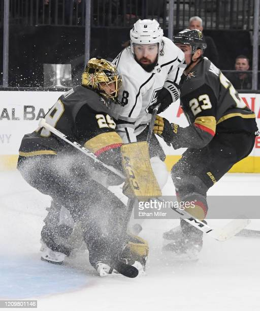Drew Doughty of the Los Angeles Kings crashes into MarcAndre Fleury of the Vegas Golden Knights in the first period of their game at TMobile Arena on...