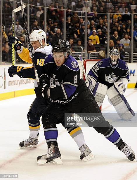 Drew Doughty of the Los Angeles Kings fights for position with Tim Connolly of the Buffalo Sabres during the game at the Staples Center on January 21...
