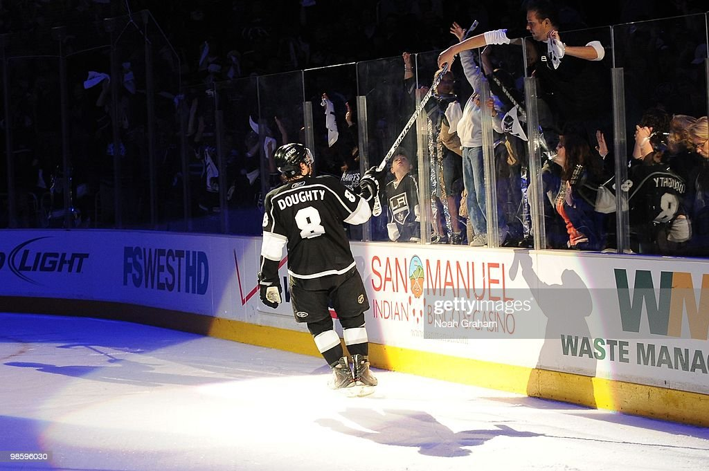 Drew Doughty #8 of the Los Angeles Kings gives his stick to a fan after defeating the Vancouver Canucks in Game Three of the Western Conference Quarterfinals during the 2010 NHL Stanley Cup Playoffs at Staples Center on April 19, 2010 in Los Angeles, California.