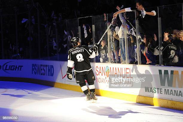 Drew Doughty of the Los Angeles Kings gives his stick to a fan after defeating the Vancouver Canucks in Game Three of the Western Conference...